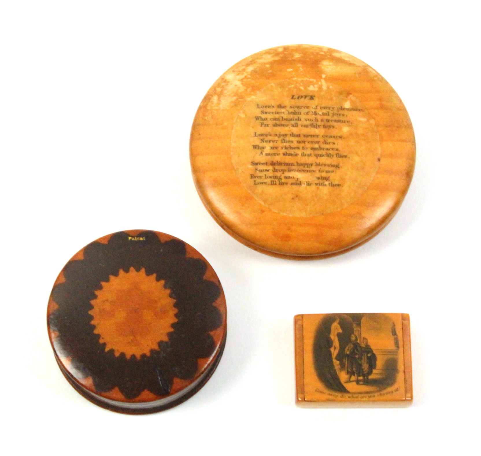 Mauchline ware - two snuff boxes and another comprising a small example, wooden hinge, the lid