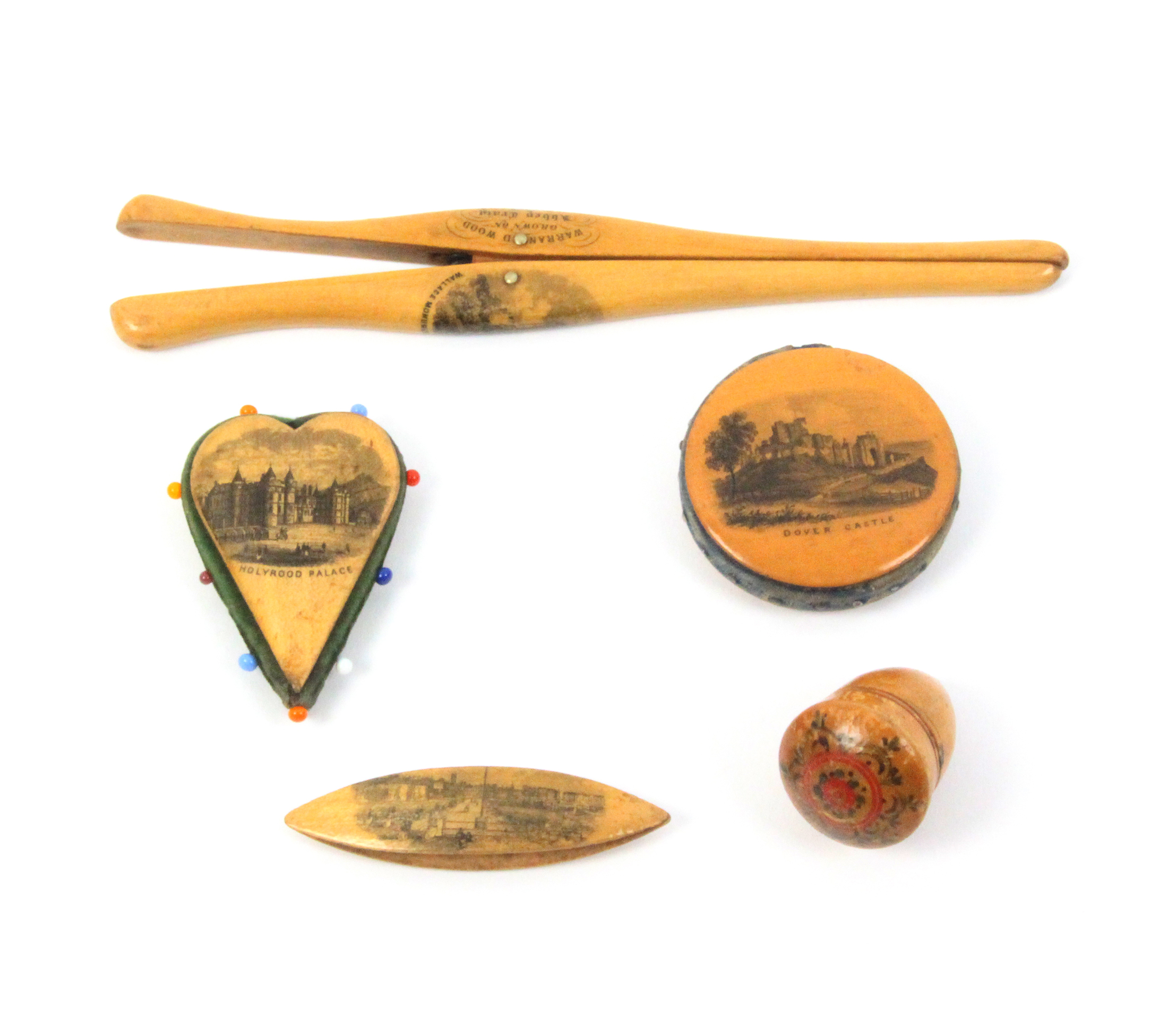 Mauchline ware - sewing - four pieces and another comprising a small shuttle (Margate From The