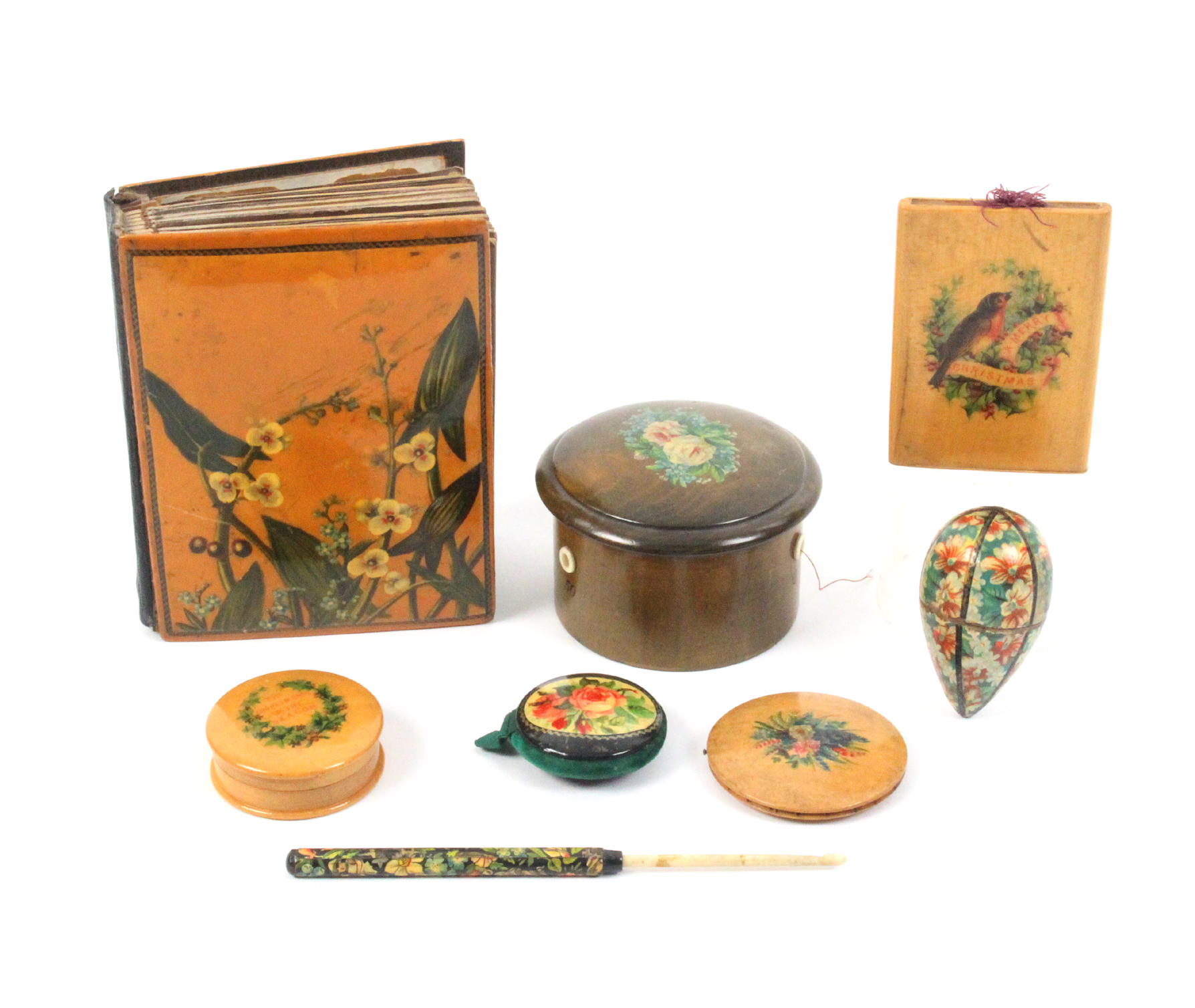 Mauchline ware - eight pieces comprising a small photograph album (floral), 13cm, a green stained