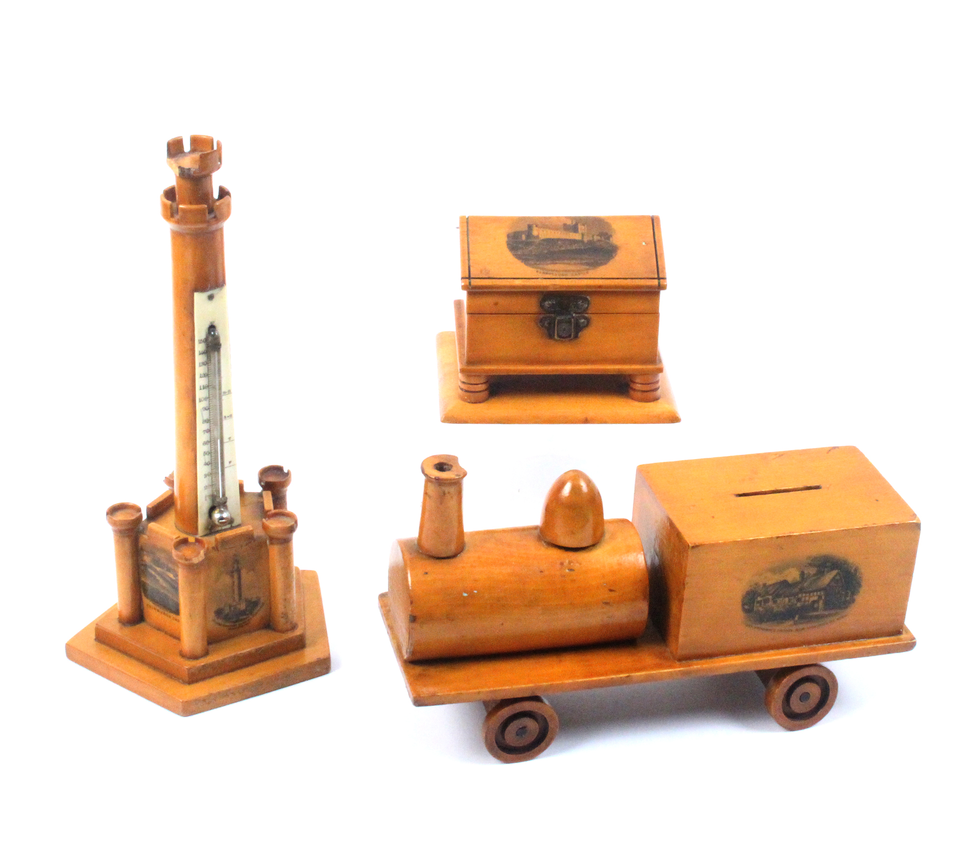 Mauchline ware - three pieces - comprising a money box in the form of a train (Ann Hathaway's