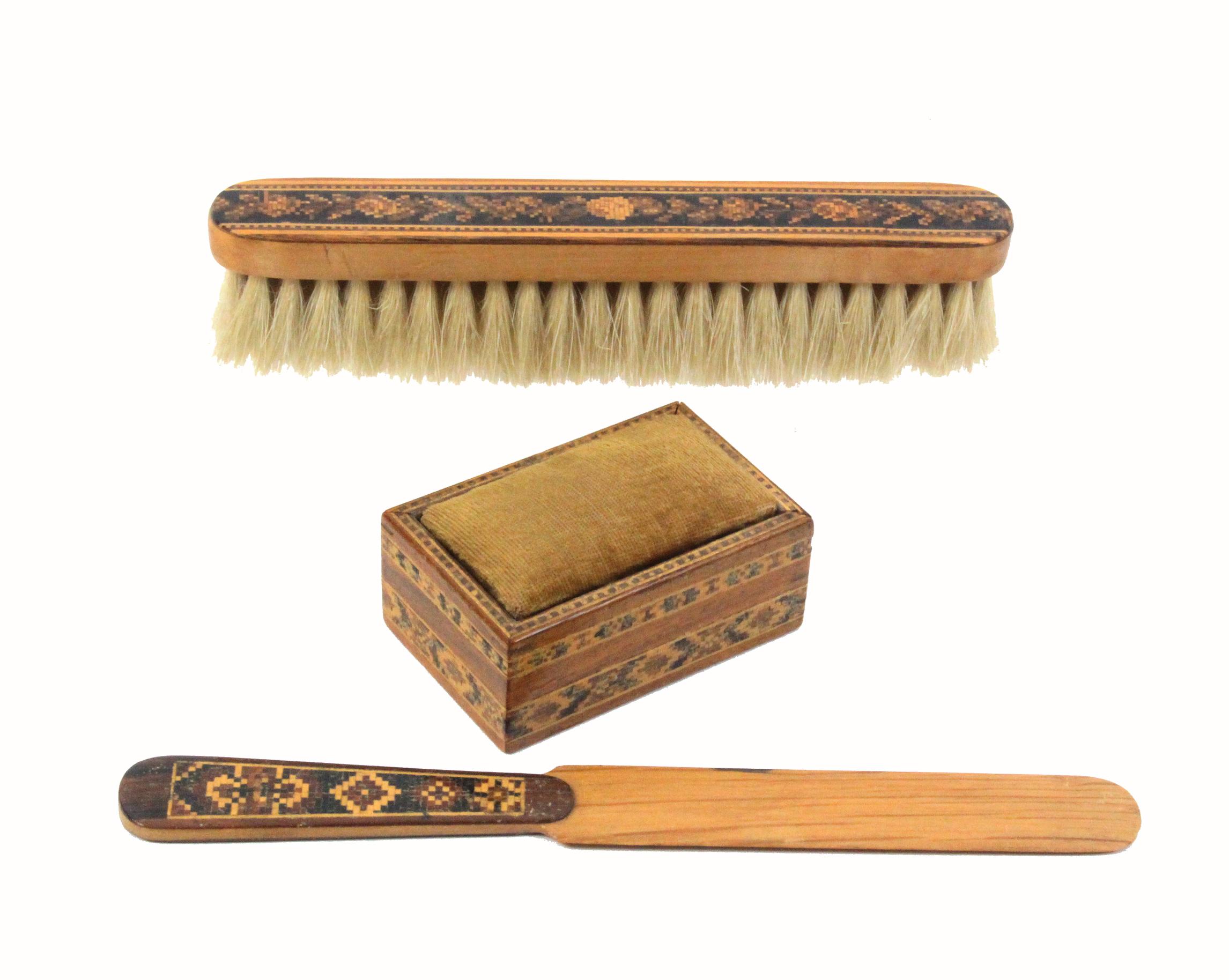 Three pieces of Tunbridge ware comprising a brush, 16.7cm, a rectangular box with sliding pin