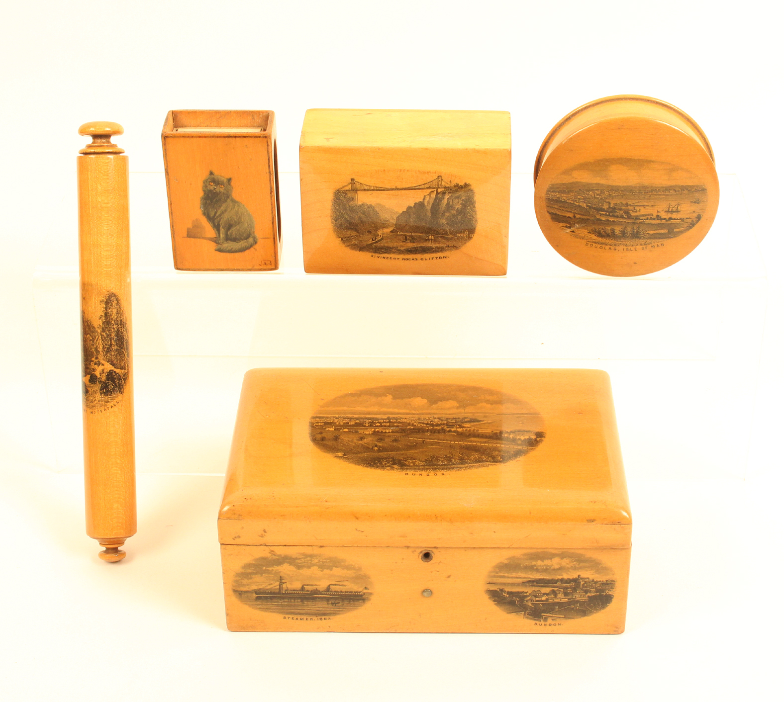 Mauchline ware - five pieces comprising a rectangular box (Dunoon/Steamer Iona/Dunoon) lacking