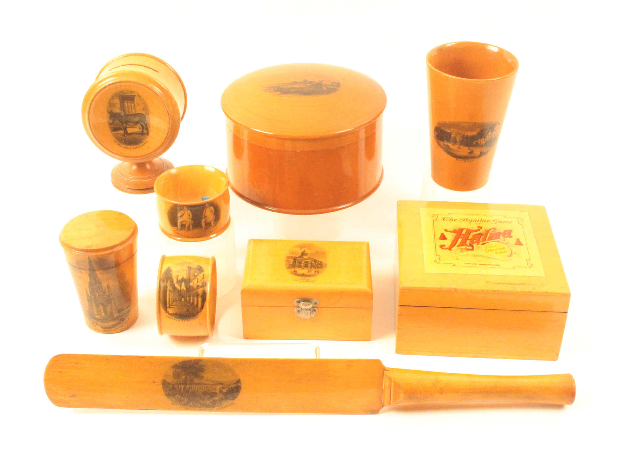 Mauchline ware - nine pieces comprising a large dome top powder box (View From West Pier, Brighton),