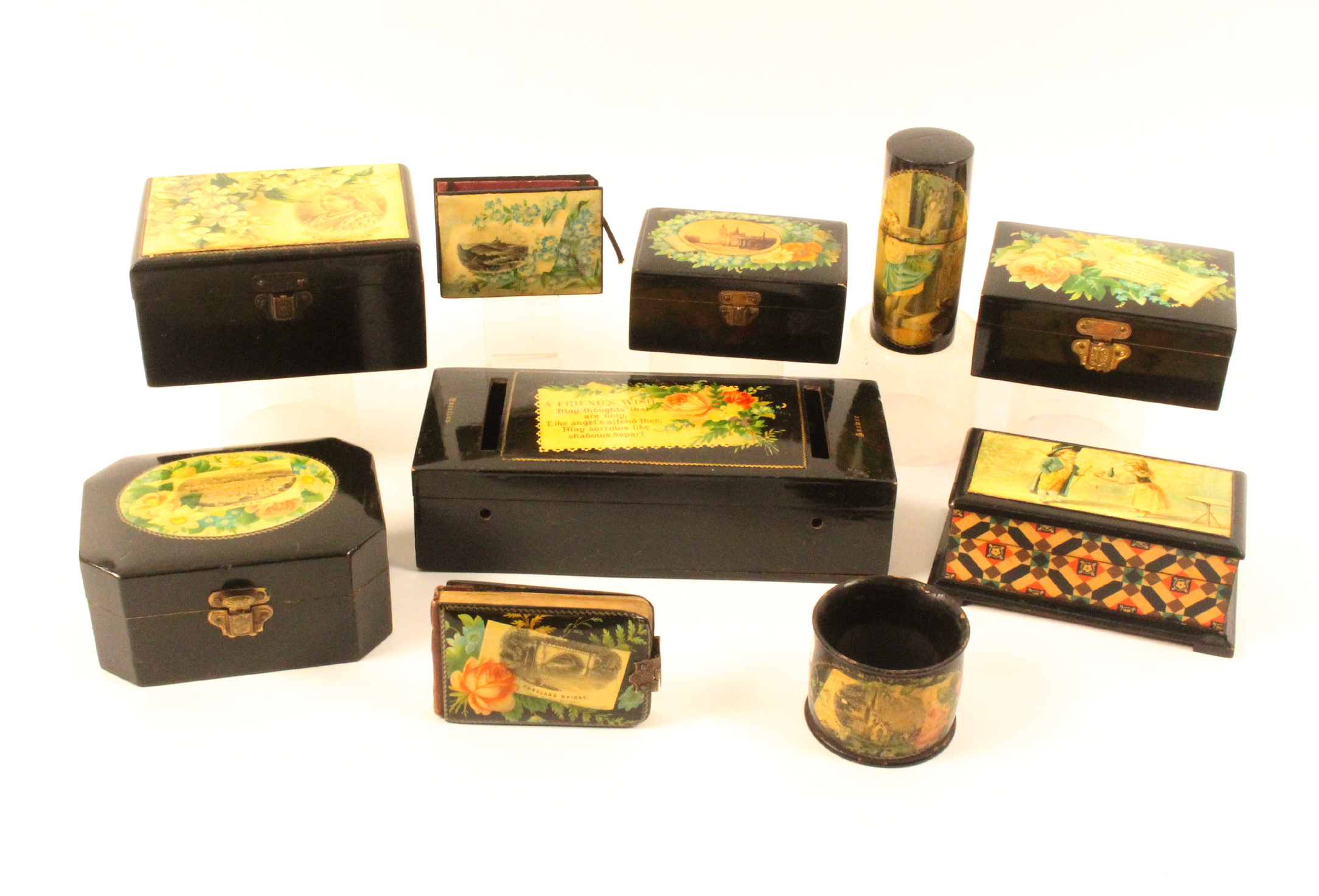 Mauchline ware - ten pieces all black ground comprising a canted rectangular box (Oban/Flowers),
