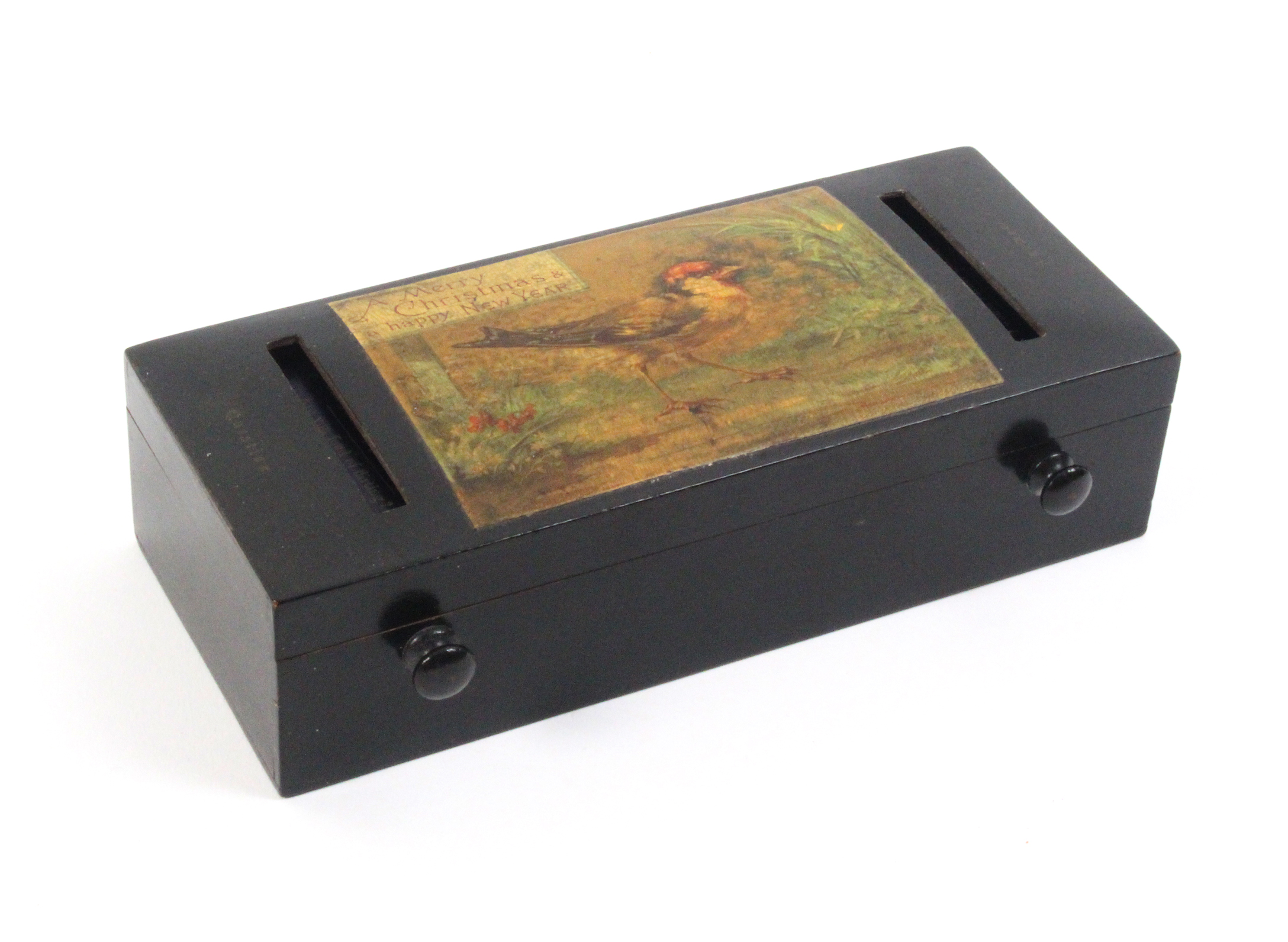 A Mauchline ware fortune telling reel box of rectangular form, black ground (bird amid foliage/A - Image 2 of 2