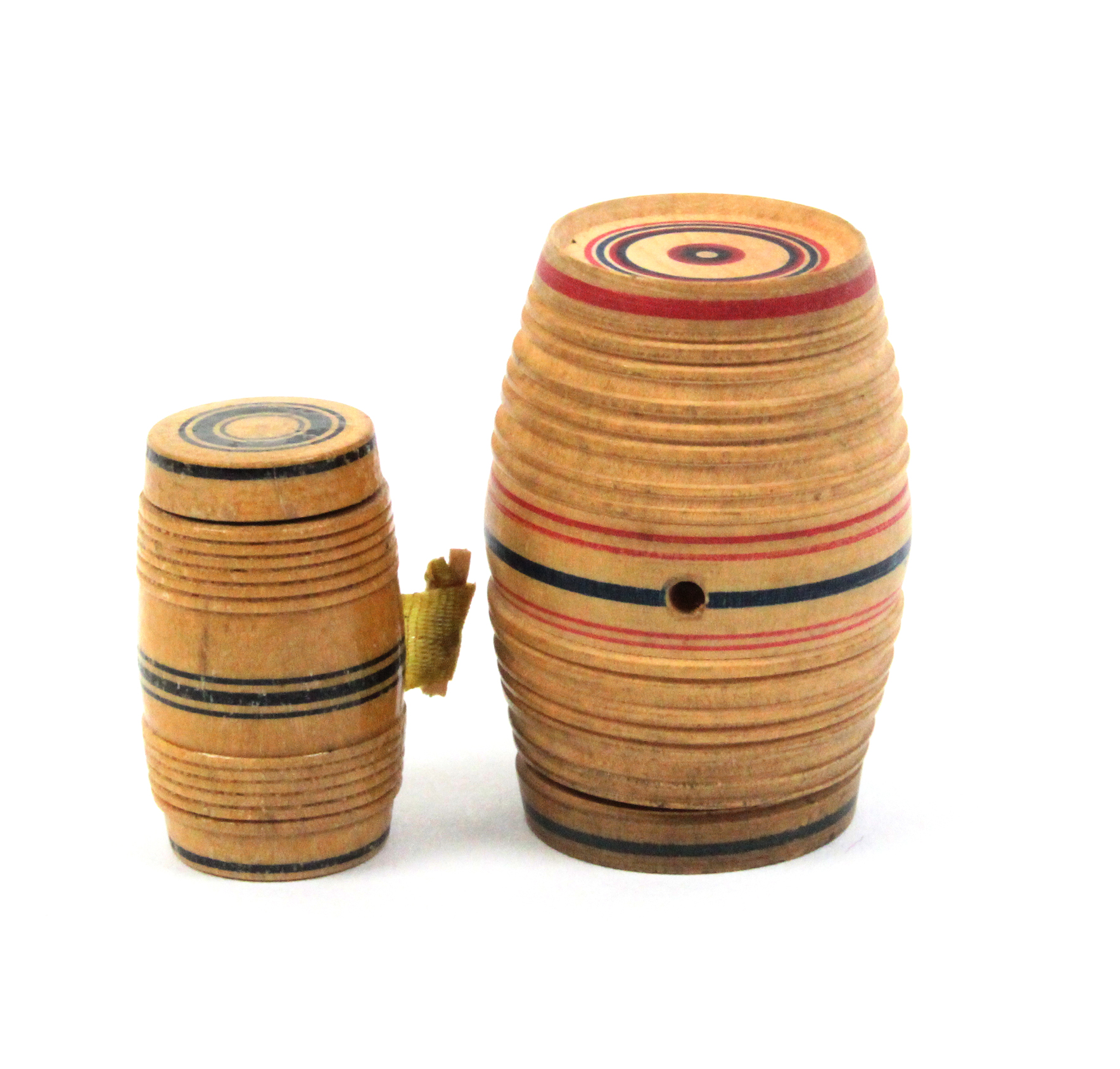 Two pieces of painted whitewood Tunbridge ware comprising a barrel form tape measure, 2.7cm, the