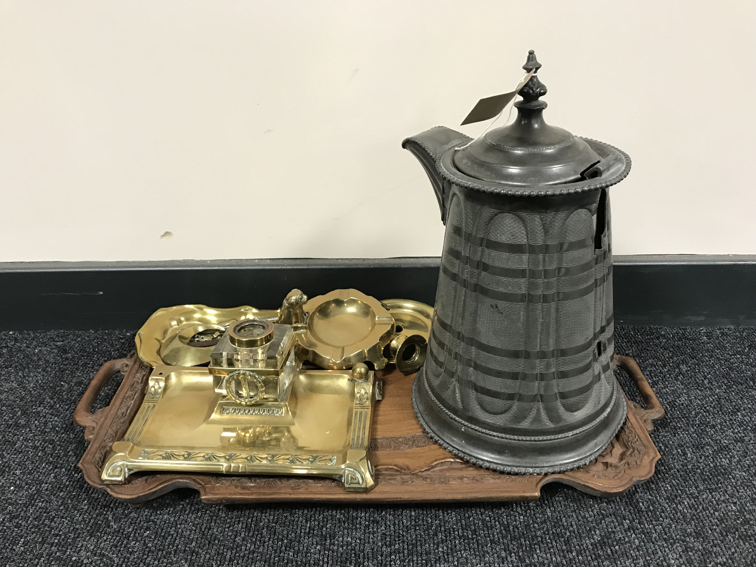 Lot 38 - A heavily carved twin handled tray and a antique pewter jug, brass desk stand,