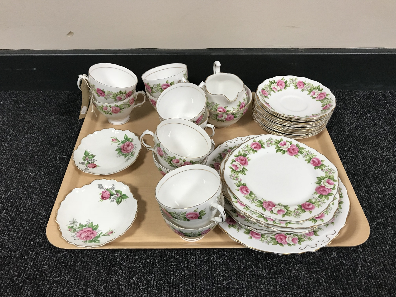 Lot 36 - A tray of thirty six pieces of Colclough pink rose tea china and a pair of Adderley plates