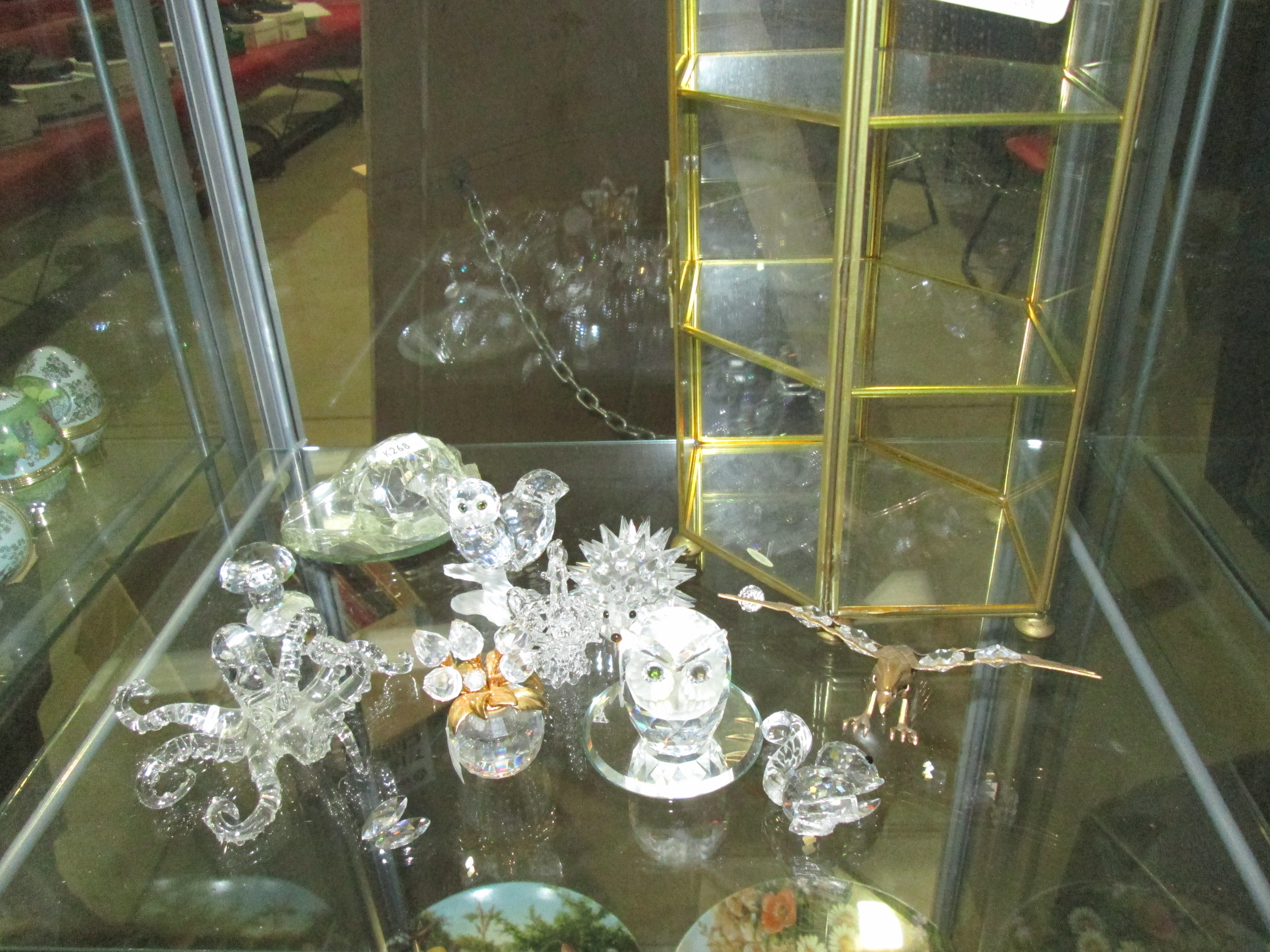 Lot 149 A Collection Of 10 Swarovski Crystal Animals And Small Display Cabinet