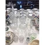 A quantity of assorted glassware including four decanters