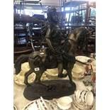 A bronze sculpture of Bedouin on horseback