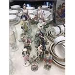 Nine porcelain figures including 18/19th Century Worcester and Derby some damaged