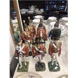 A collection of eight Dresden plus one Sevres porcelain figures of solders,