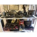 An assortment of metalware including vintage tins etc
