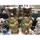 A pair of Chinese temple vases,