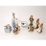 A collection of four Hummel figures of children, two Beswick Beatrix Potter figures of Mr Benjamin