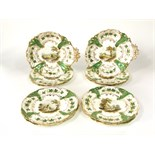 A good quality 19th century dessert service with central painted landscape panels within green and