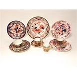 A collection of early 19th century and later tea and other wares with painted and gilded Imari