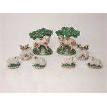 A pair of early 19th century Staffordshire type models of sheep with bocage together with two