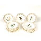 A 19th century Coalport type dessert service attributed to John Randall, with central painted