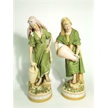 A pair of large early 20th century Royal Dux figures of male and female water carriers, both in