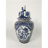A large Belgian Boch vase and cover in the Delft manner with blue and white printed floral