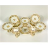 A good quality 19th century dessert set with pierced and gilded decoration to the borders and floral