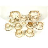 A collection of mid 19th century tea wares with gilded fruiting vine detail comprising tea pot,
