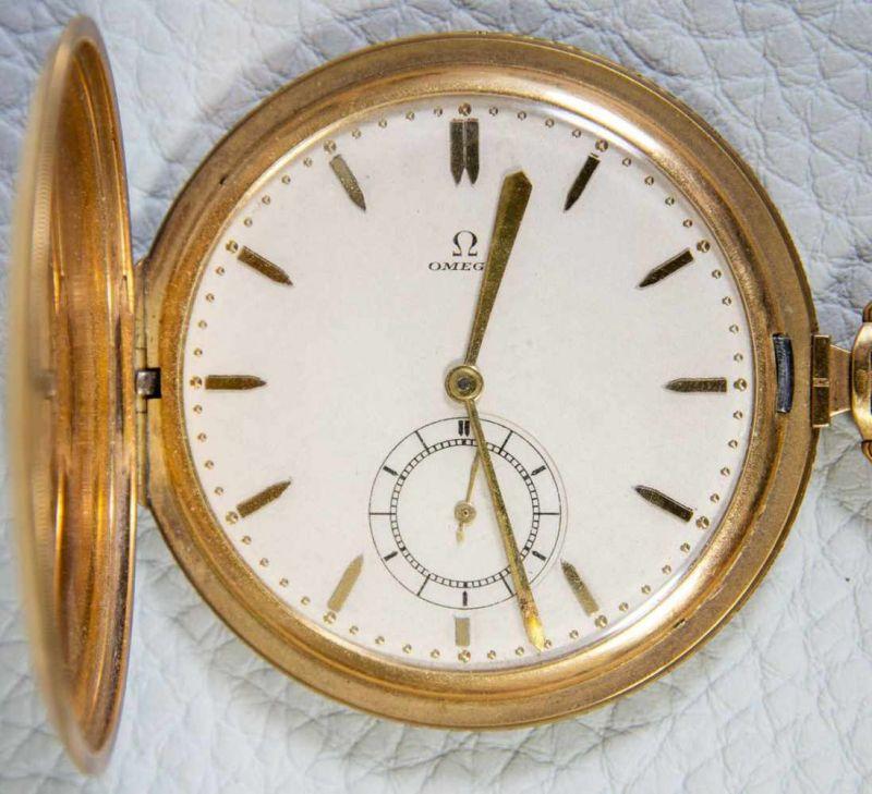 OMEGA Sprungdeckeltaschenuhr, 585er/14K Gelbgoldgehäuse & Uhrenkette. Brutto ca. 79 gr. Werk läuft