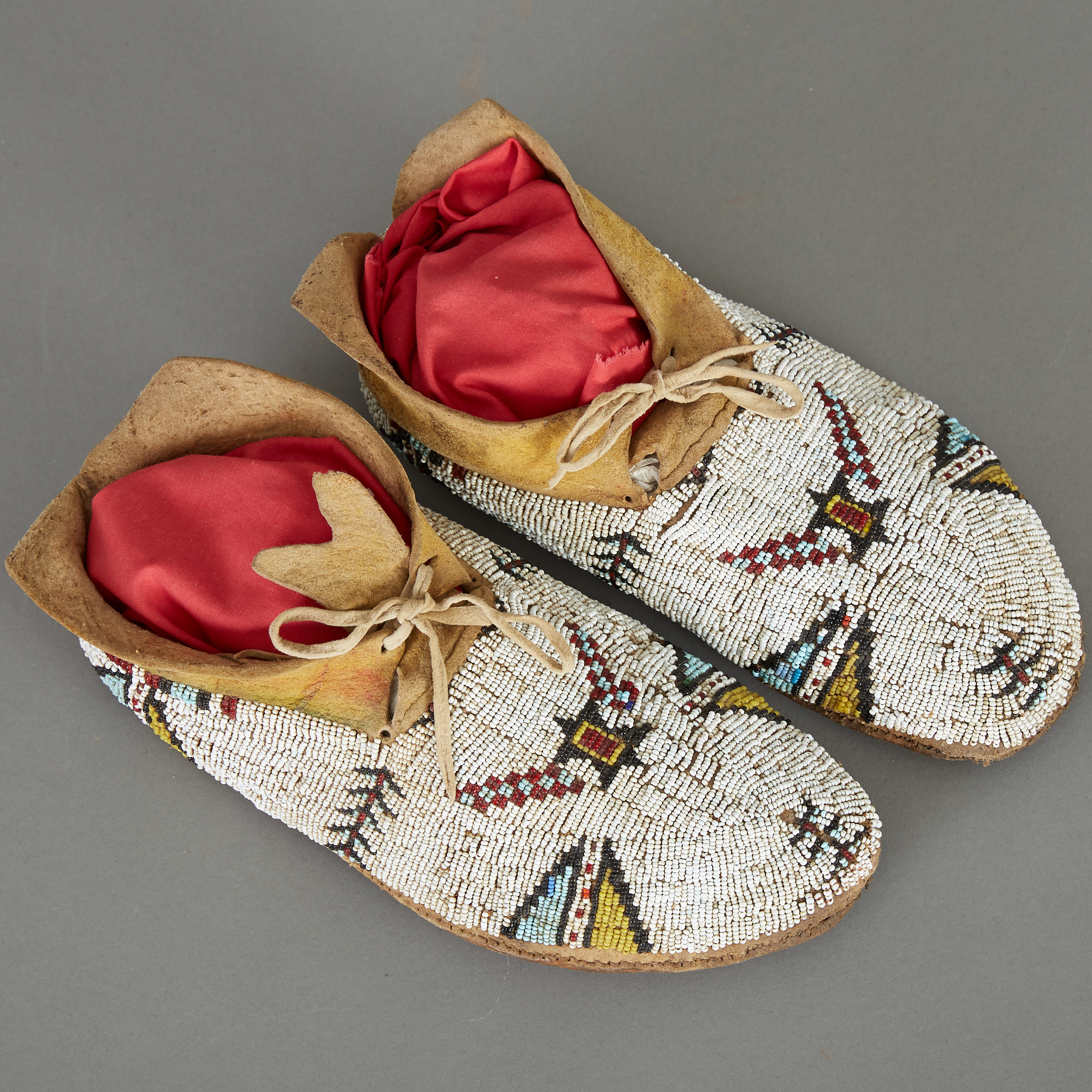 Lot 248 - Cheyenne Beaded Moccasins Sinew Sewn ca. 1890