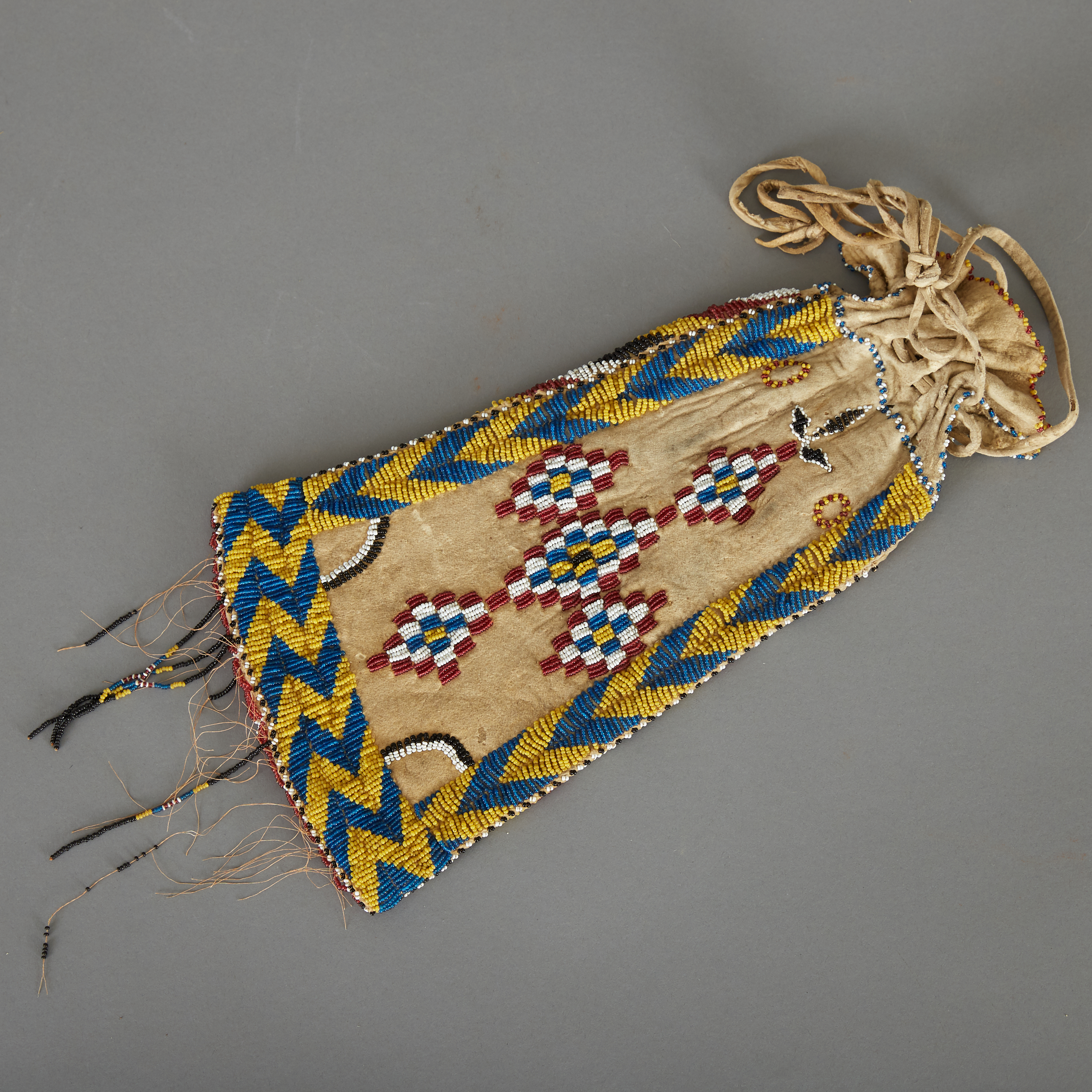 Los 228 - Apache beaded pouch/lady's pipe bag. Tanned hide, sinew sewn, beaded on both sides with zig zag...
