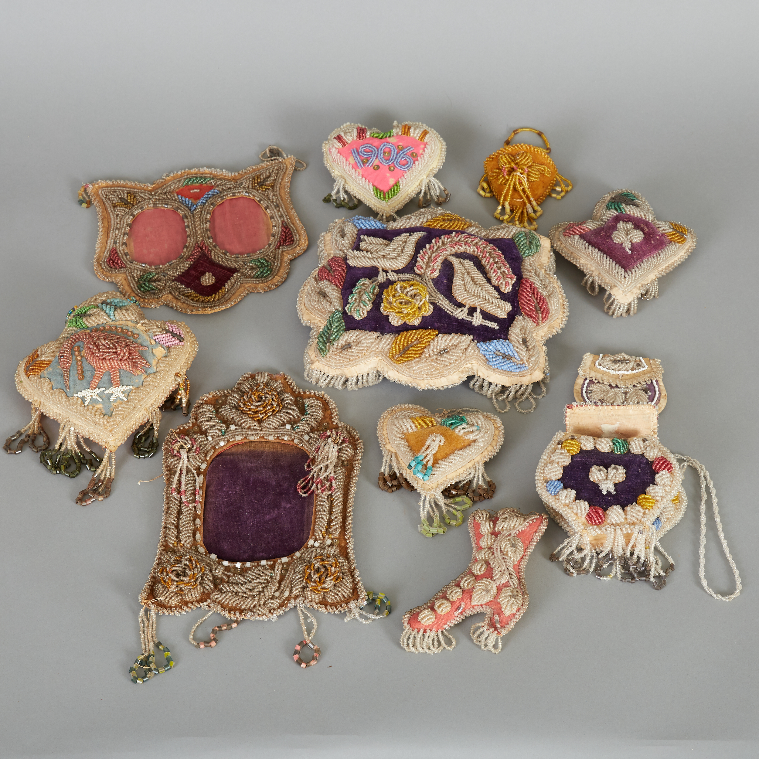 Los 221 - Eleven Iroquois beadwork objects. Two picture frames, one pillow with a bird motif, and seven...