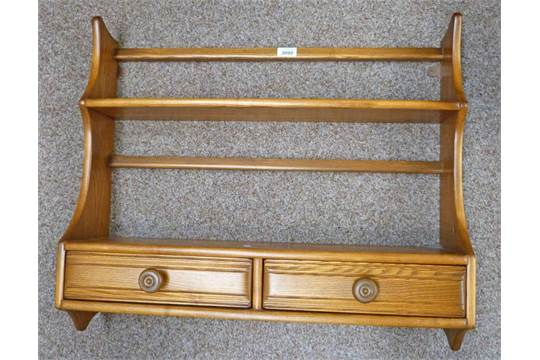 & 20TH CENTURY ERCOL STYLE WALL MOUNTED PLATE RACK WITH TWO DRAWERS