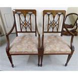 A pair of Edwardian string and marquetry inlaid mahogany framed open arm chairs,