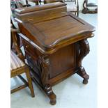 A modern reproduction of a Victorian mahogany Davenport with a hinged top,