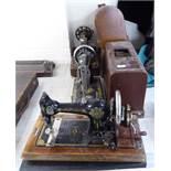 Two similar manual Singer sewing machines, model no.