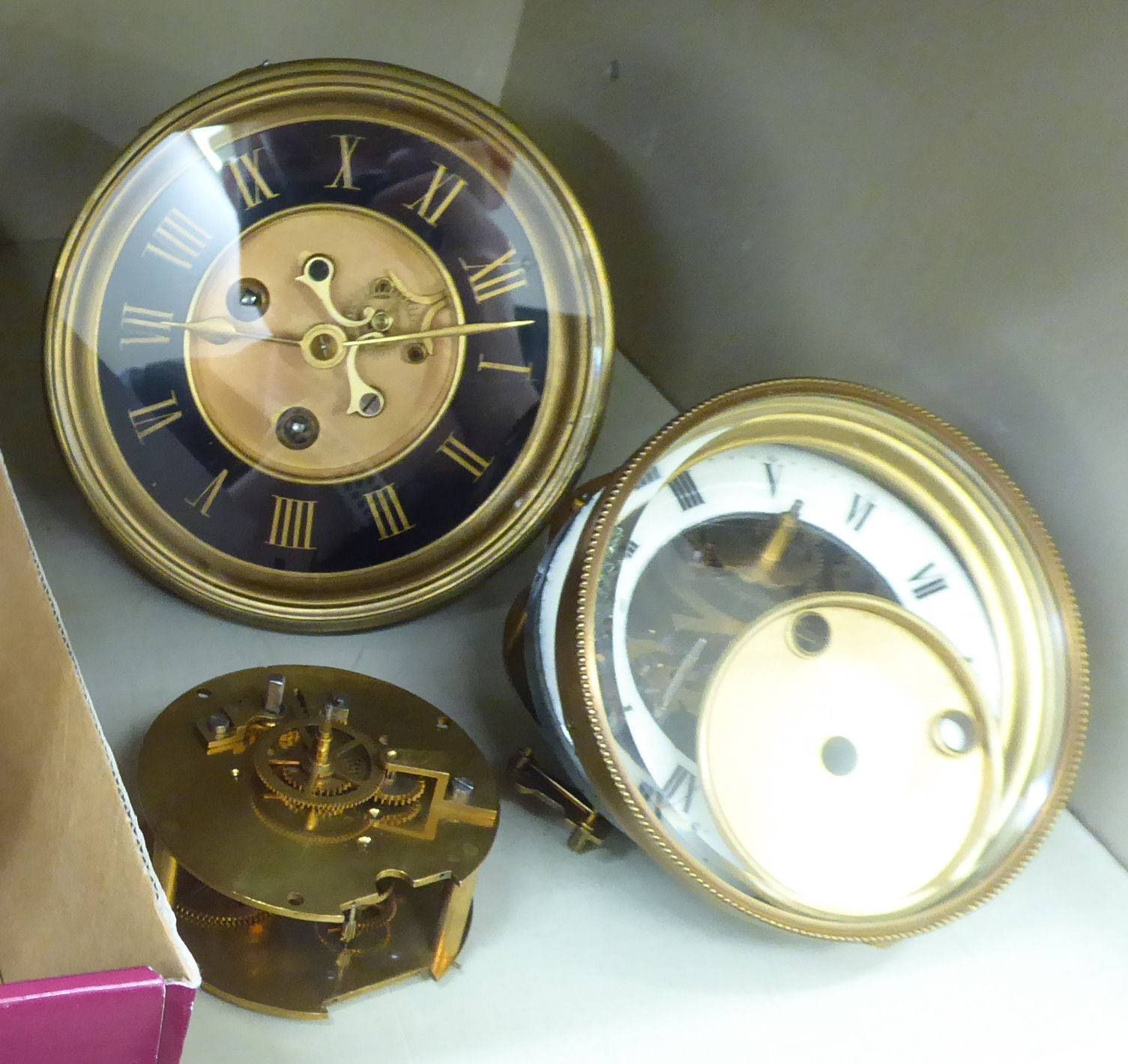 Lot 54 - Seven late 19thC clock movements: to include an 8 day example with an enamel Roman dial OS5