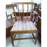 A mid/late 19thC beech and elm framed country made elbow chair, the later covered,