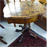 A late 19thC work table, the serpentine outlined crossbanded mahogany top with a frieze drawer,