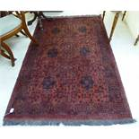 A Persian design rug decorated with stylised floral designs on a red ground 50'' x 74'' BSR