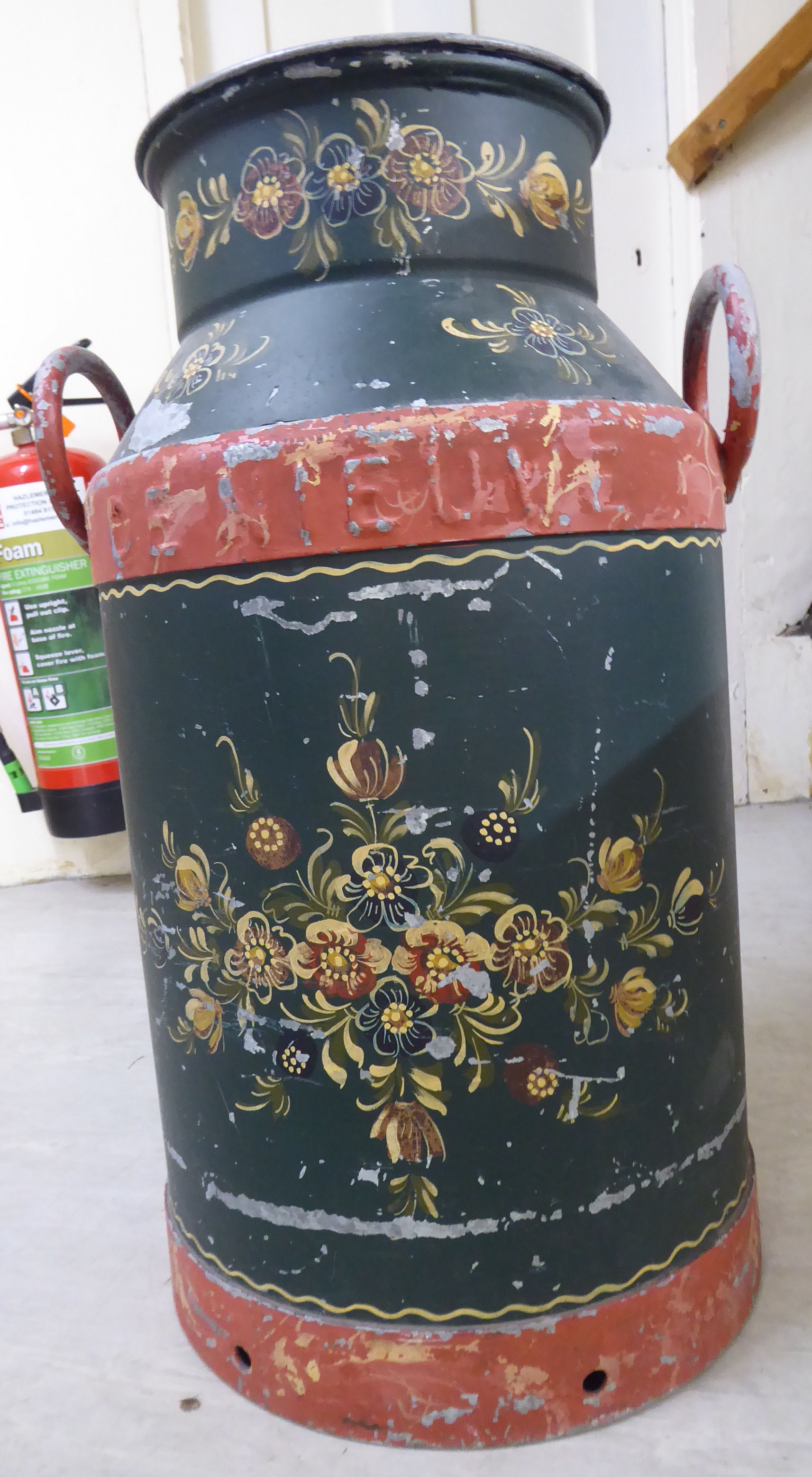 Lot 49 - A Victorian style painted cast metal milk churn 23''h BSR