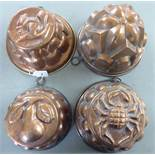 Four Victorian style copper jelly moulds of domed form,