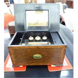 A late Victorian crossbanded walnut and rosewood finished music box with straight sides and a