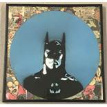 A framed and glazed vinyl record painted with Batman design.