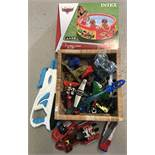 A collection of assorted toys to include boxed and sealed Disney Cars paddling pool.