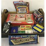 A collection of vintage games and packs of playing cards.