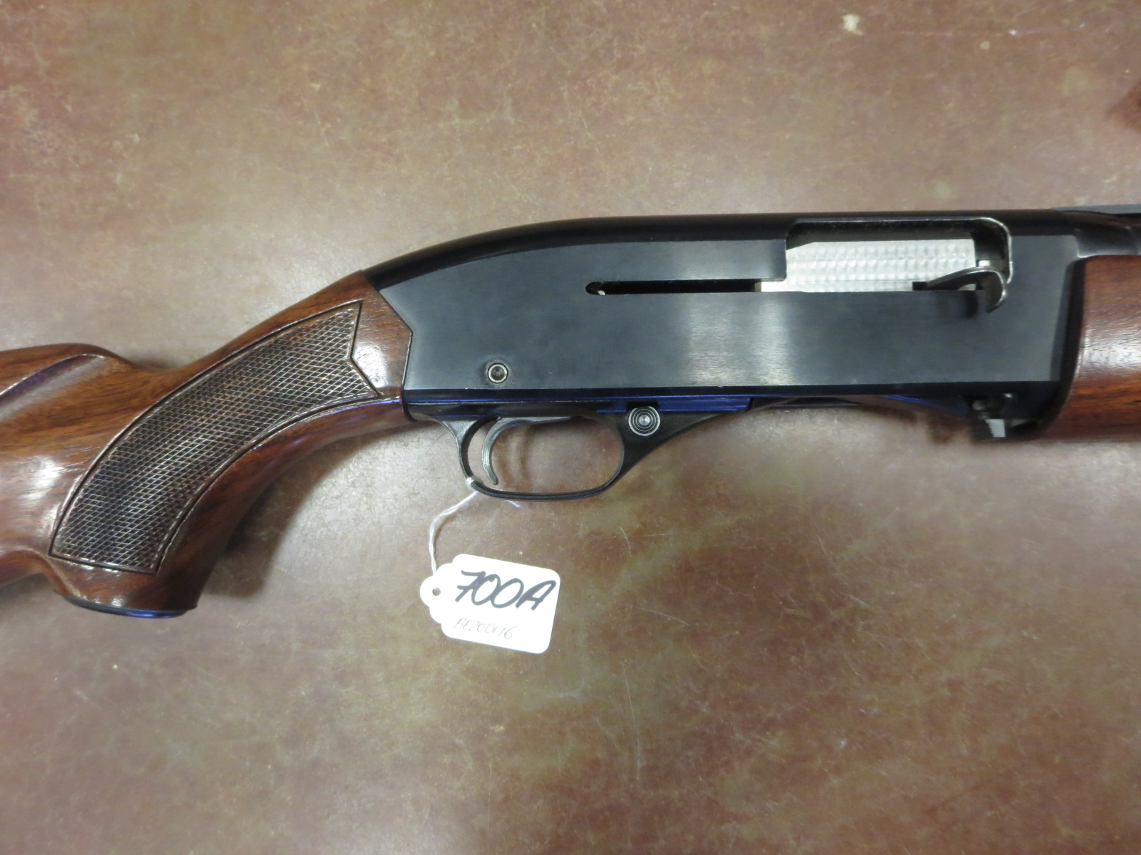 A Winchester 1400 Mark II semi-automatic 12 bore 3-shot shotgun 2 3