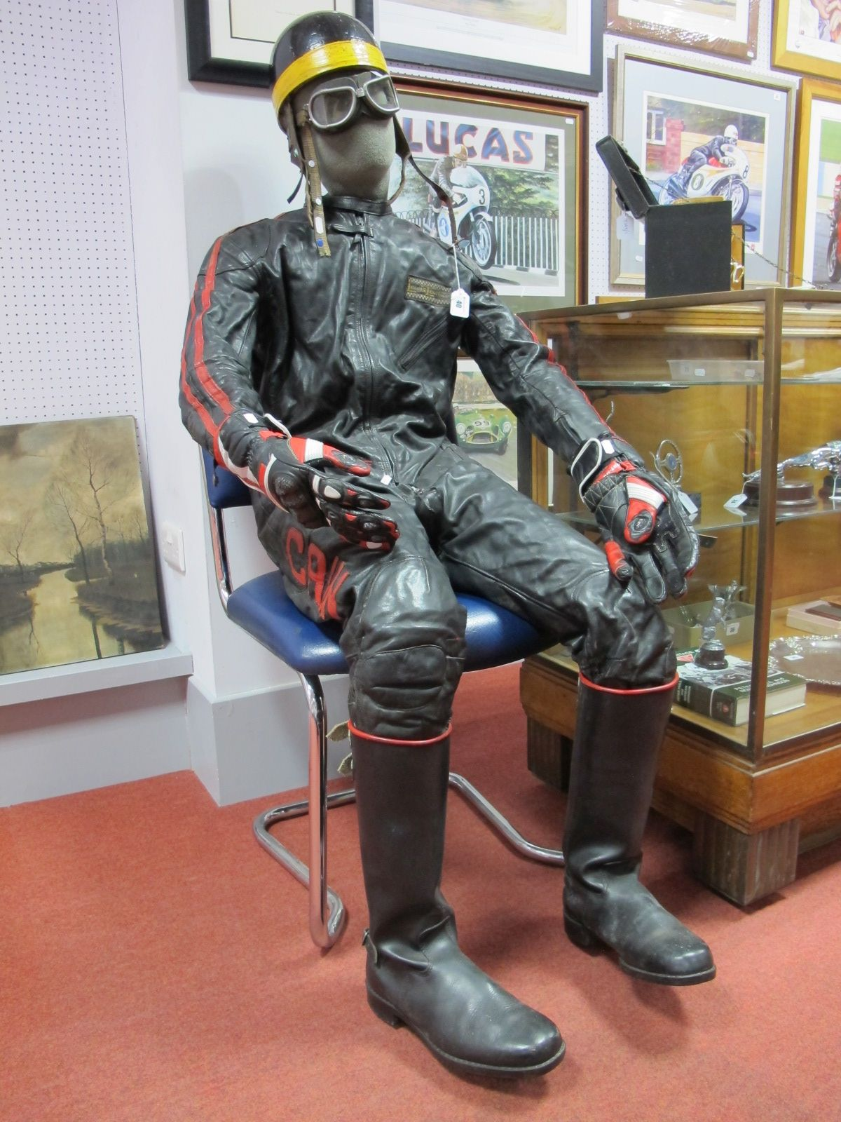 Lot 40 - Late 1960's/ Early 1970's Lewis Motorbike Racing, one piece leather suit, black with red detail