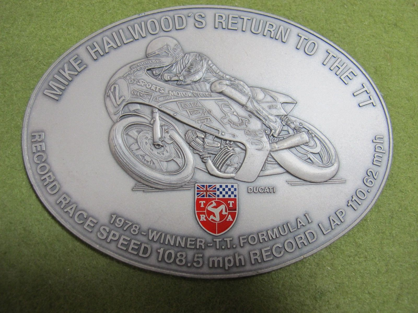 Lot 20 - ATTRA Oval Plaque- 'Mike Hailwoods' 'Return to The TT.'