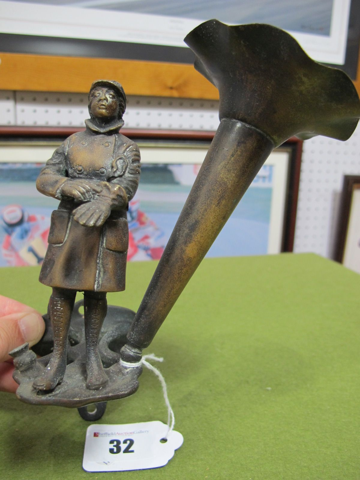 Lot 32 - An Edwardian Wall Mounted Twin Posy Holder, brass, with figure of early motorist figure, missing one
